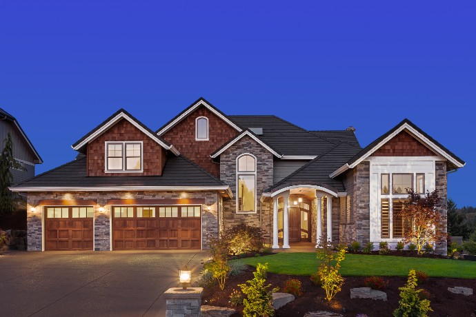 Front exterior of luxury home in evening